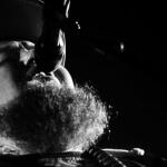 Rag 'n' Bone Man in black and white sings into mic